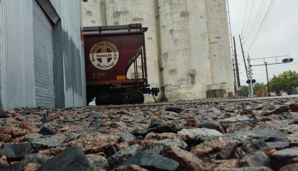 Santa Fe train car and old grain elevators